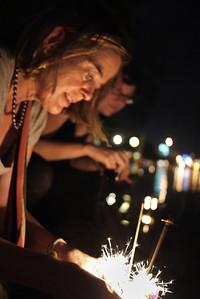 Naomi lights her krathong during Loy Krathong in Chiang Mai, Thailand
