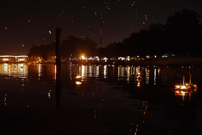 Lanterns in the sky, candlelit krathongs on the river and a vibrant city during Loy Krathong in Chiang Mai, Thailand