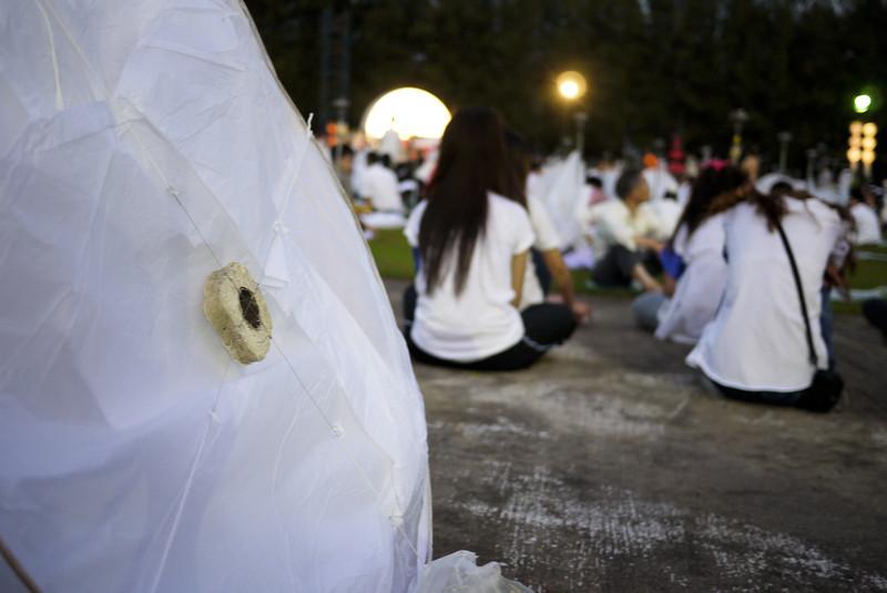 Large lanterns and meditators during Loy Krathong in Chiang Mai, Thailand