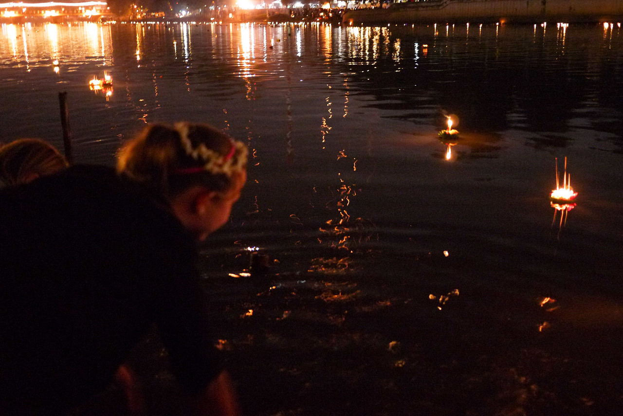 Ana floating her krathong on the river during Loy Krathong in Chiang Mai, Thailand