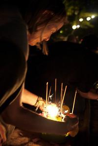 Naomi prepares to release her krathong during Loy Krathong in Chiang Mai, Thailand