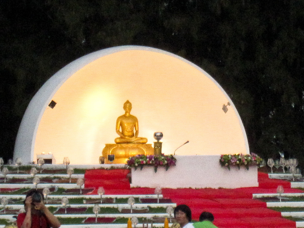 Buddha sits at the front of the temple grounds during Loy Krathong in Chiang Mai, Thailand
