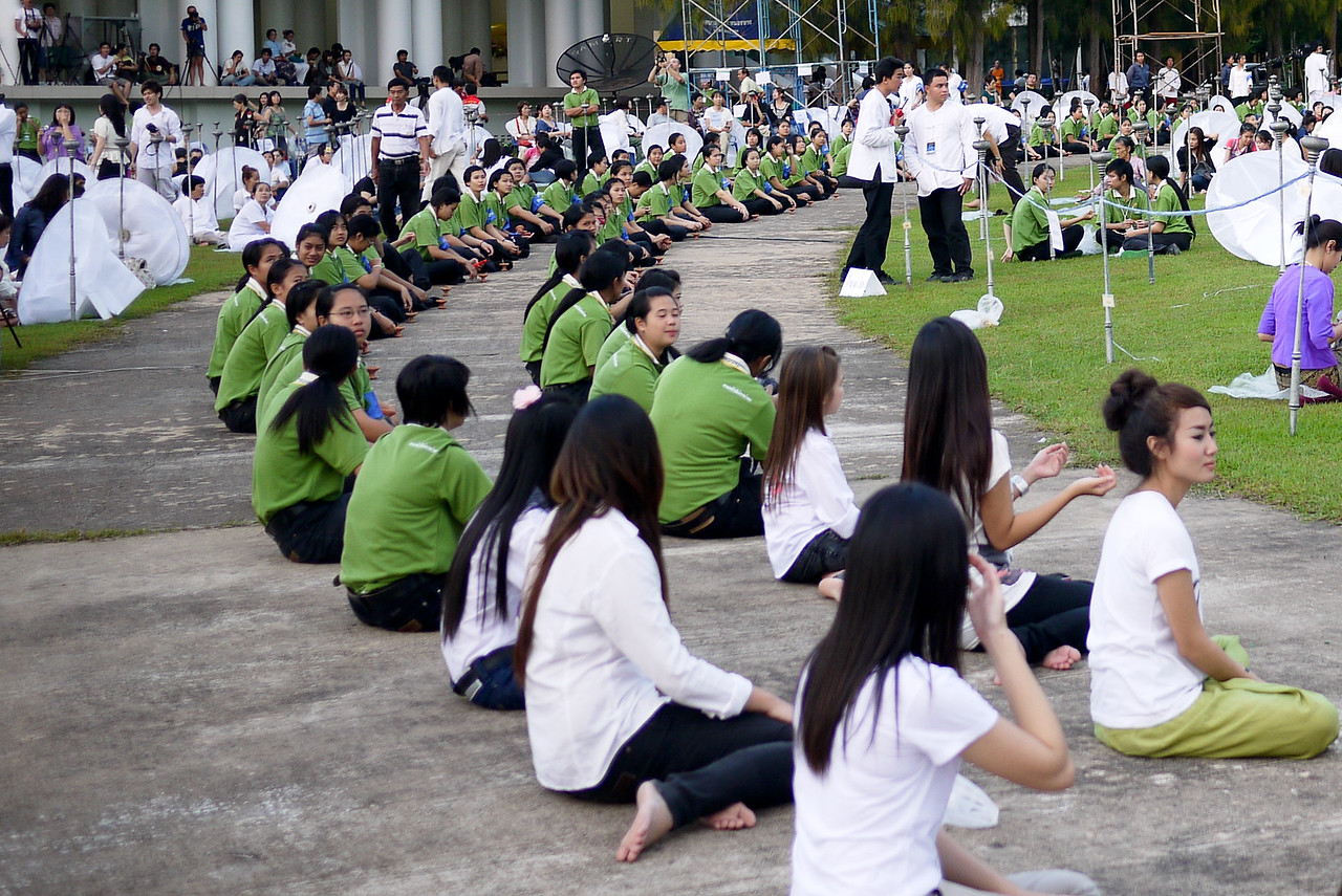 Organizing the event before dusk settles during Loy Krathong in Chiang Mai, Thailand