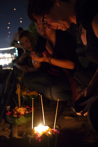 Catherine prepares her krathong for release during Loy Krathong in Chiang Mai, Thailand