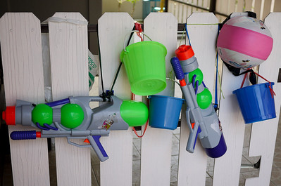 Our fence lined with the trappings of Songkran fun in Chiang Mai, Thailand