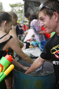 Mischievous faces line the streets for Songkran in Chiang Mai, Thailand