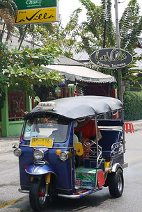 Celebrations are underway as a passing tuk-tuk is pummeled with water! Songkran in Chiang Mai, Thailand.