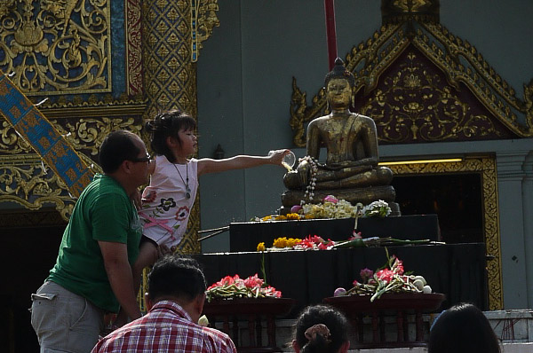 bathing the buddha during songkran