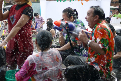 Another one hit with the ice-cold water during Songkran in Chiang Mai, Thailand