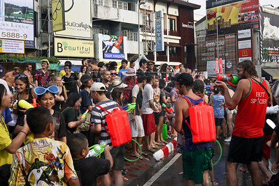 Backpacks with squirt guns mean a lot more water storage for Songkran in Chiang Mai, Thailand