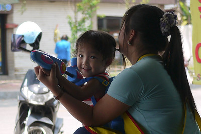 This little girl is very prepared and ready to start Songkran water fighting activities! Chiang Mai, Thailand.