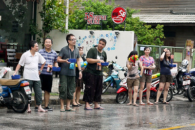 Revelers wait for motorbikes on the streets for Songkran in Chiang Mai, Thailand