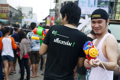 Slightly respectful, he let's me get my photo before spraying me with water during Songkran in Chiang Mai, Thailand!