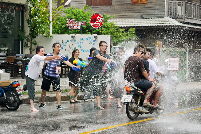 Motorbikes are not spared during Songkran in Chiang Mai, Thailand