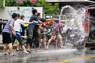 Splashing the motorbikes for Songkran in Chiang Mai, Thailand.