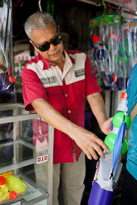 Checking the viability of a water gun purchase in preparation for Songkran in Chiang Mai, Thailand.