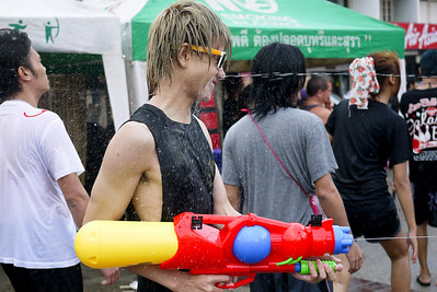 Taking a water stream right to the face for Songkran in Chiang Mai, Thailand