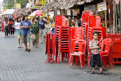 Street stalls line the main walking street all day long for Songkran in Chiang Mai, Thailand