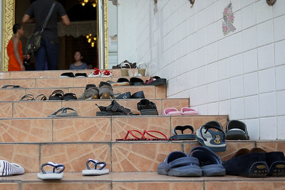 Shoes left outside the temple for Songkran in Chiang Mai, Thailand