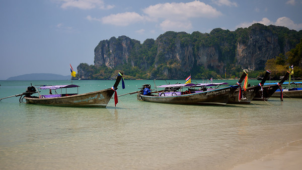 The longboats and aqua waters of Railay Beach in the Thai islands.