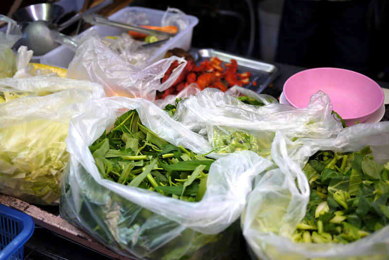 Array of veggies ready for made-to-order street food in Thailand.