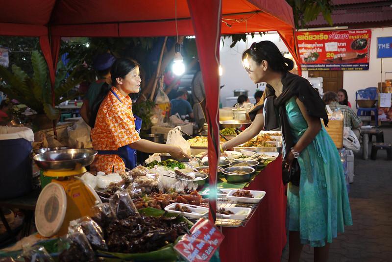 Food stalls at the Sunday night market, Chiang Mai, Thailand.