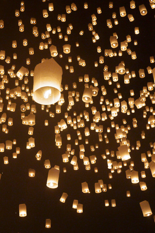 A sea of amber colored lanterns during Loy Krathong in Chiang Mai, Thailand