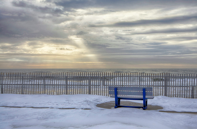 February 2014 Smith Point Beach<br /> It wasn't much of a sunrise with heavy clouds but as I was about to leave the sun was breaking through. The light streak lead straight to the bench. Like it was kinda telling me something.