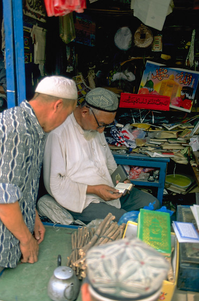 Old man in bookshop on the market of Kashgar, Xinjiang Uygur Autonomous Region, China