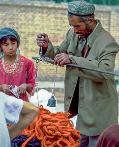 Marketeer and his daughter in Kashgar, Xinjiang Uygur Autonomous Region, China
