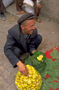 Marketeer selling figs on leaves in Kashgar, Xinjiang Uygur Autonomous Region, China