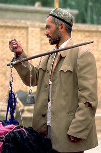 Marketeer with simple set of scales in Kashgar, Xinjiang Uygur Autonomous Region, China