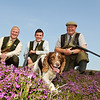 Gamekeeping Student of the Year Askham Bryan College student Anthony Orr (centre) with his tutor Andrew Emsley(left) and Head Gamekeeper of Spaunton Moor George Thompson with Anthony's dog Winnie.