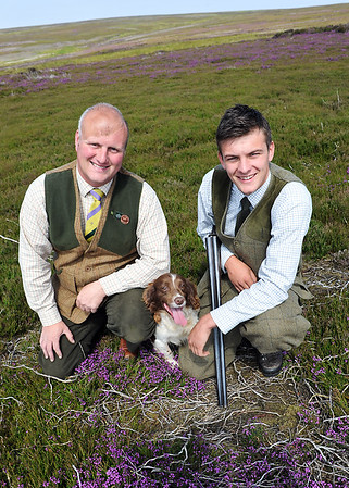 Askham Bryan College tutor Andrew Emsley(left) with Gamekeeping student of the Year Anthony Orr and his dog Winnie.