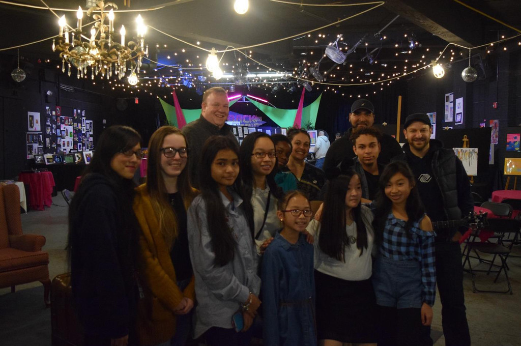 . Local artists and staff members from Boys and Girs Clob of Greater Lowell psoe for pictures during Saturday night�s regional art exhibit at the Onyx Room. From left: Na Lam, staff; Meghan Jewell, 14; Sorida Hou, 13; Melanie Khiem 16, Alanah Chhum-Mam, 10; Tristen Huynh, 14; Angelina Khiem, 12; Portia Yeboah, 14; and Nicholas Figueroa, 17. Back row staff from left: Joe Hungler, Alisha Harrison, Frank Porceano, JuanCarlos Rivera. Absent from photo; Mike Jewell, 12; Kiki Welch, 17.