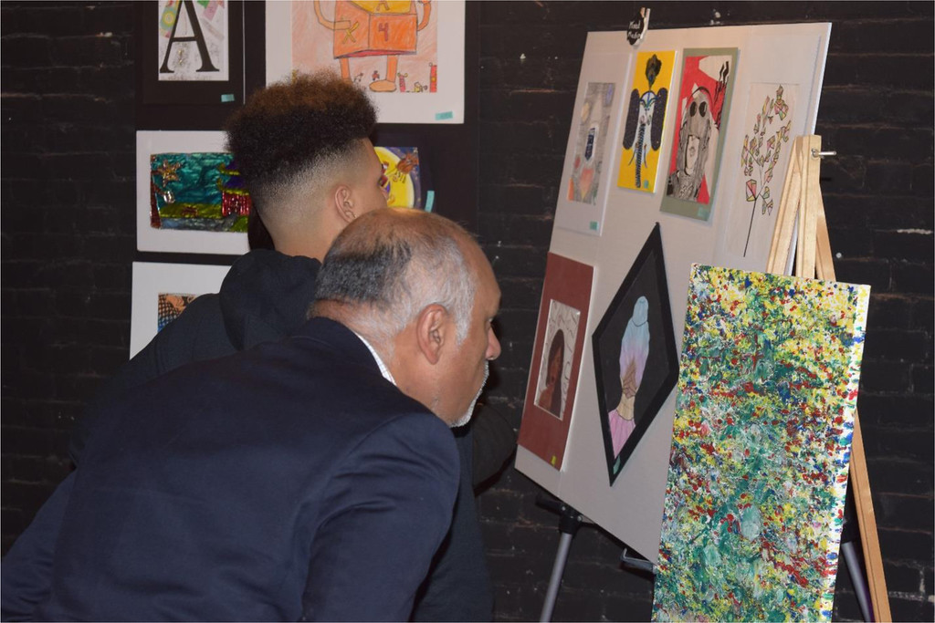 . Among the many visitors to the Onyx Room for Saturday night�s art exhibit was congressional candidate Beej Das (front).