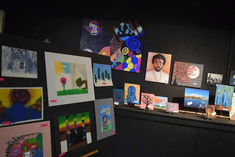 An eclectic selection of paintings greeted visitors at the Onyx Room for Saturday night's art exhibit.