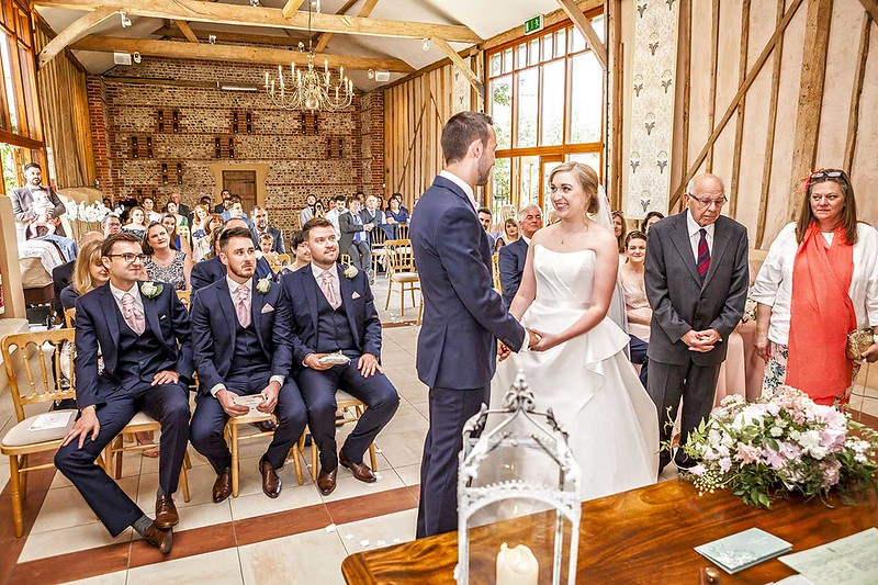 bride and groom exchanging wedding vows