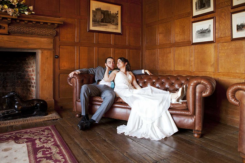bride and groom sitting on a sofa