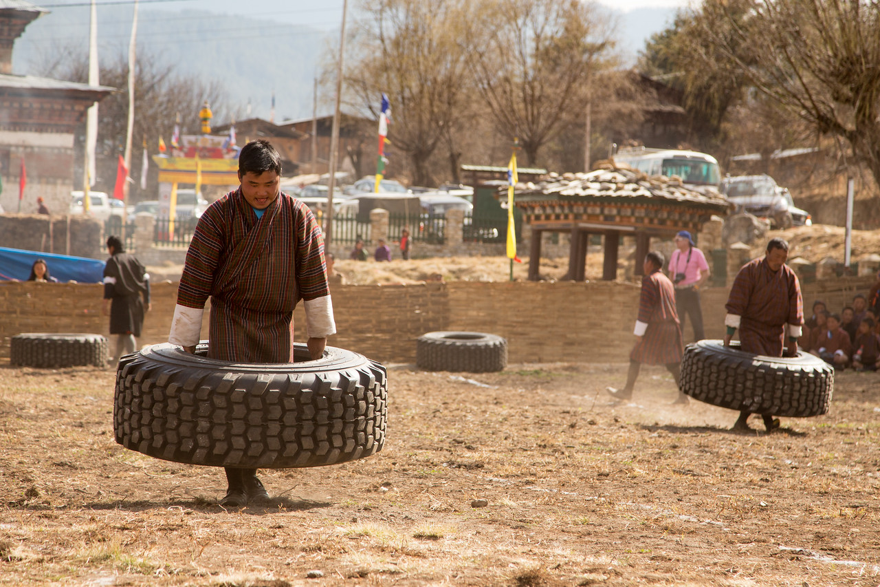 Carrying Tires at Bhutan's Nomad Festival