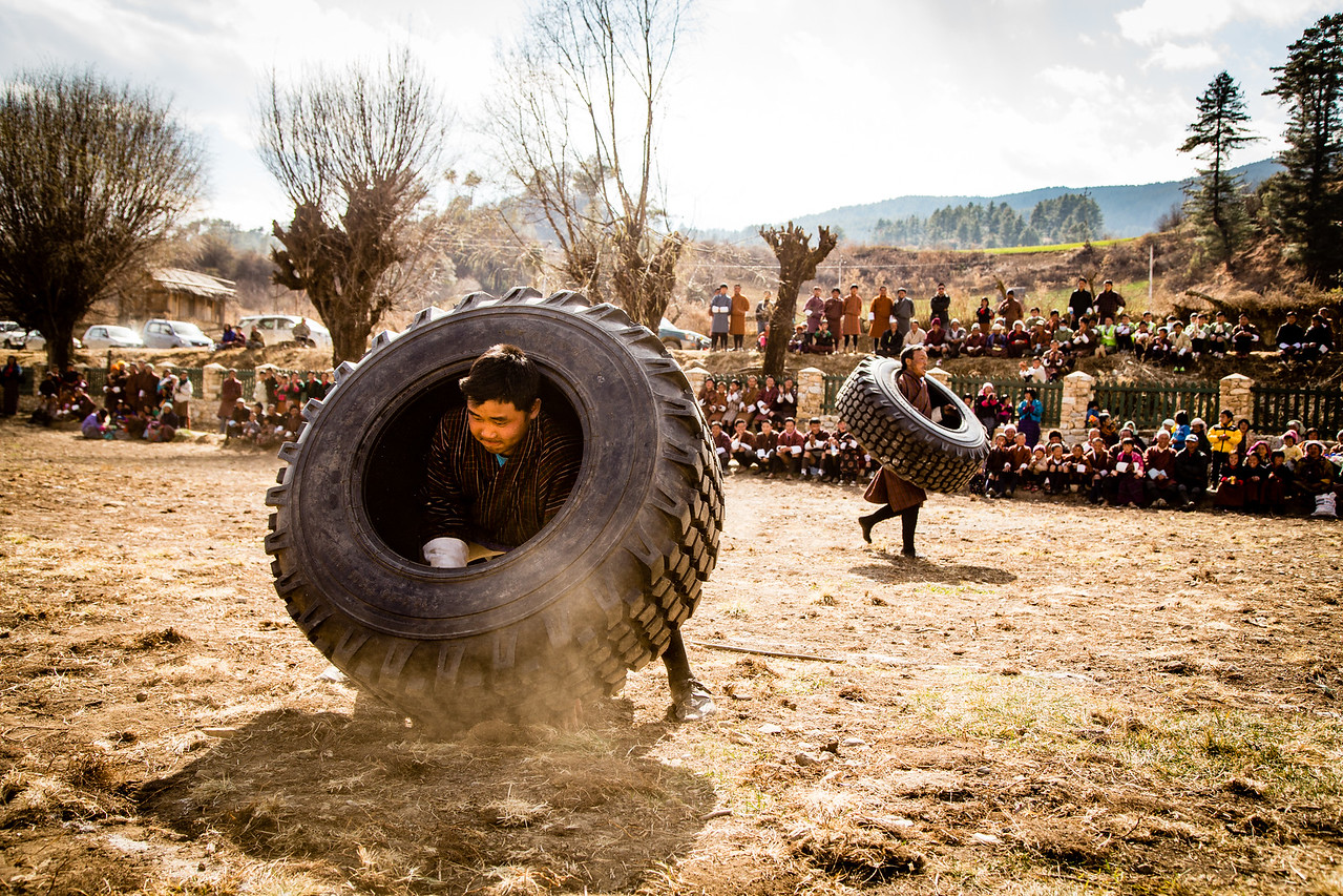 Different Technique for Carrying Tires at Bhutan's Nomad Festival