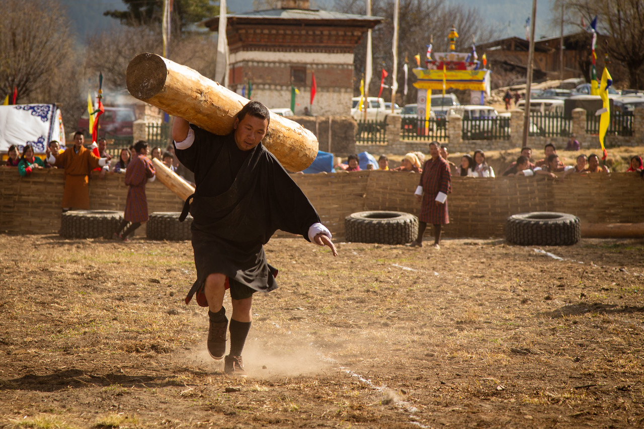 Carrying a 100 Kilogram Log at Bhutan's Strongman Competition