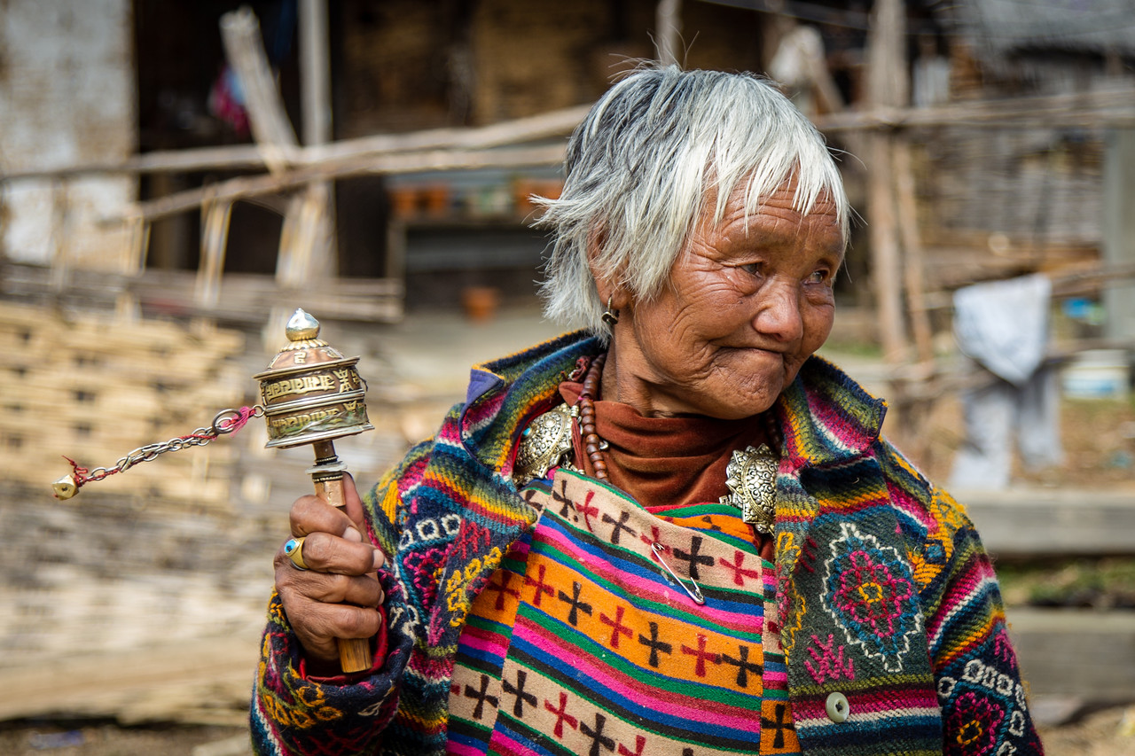 Bhutanese Woman with Prayer Wheel