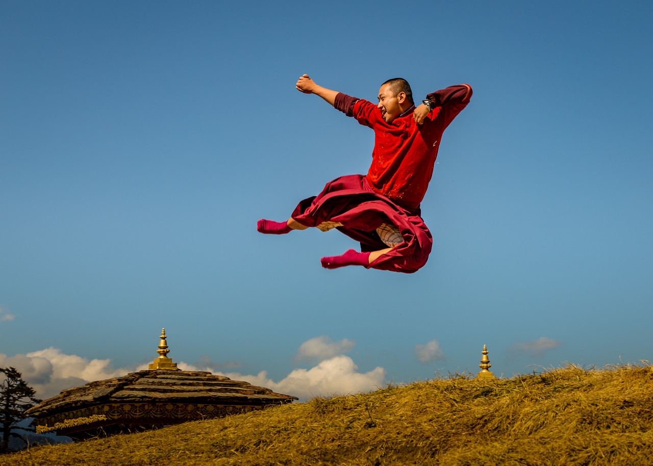 Bhutan Monk Flying Through the Air