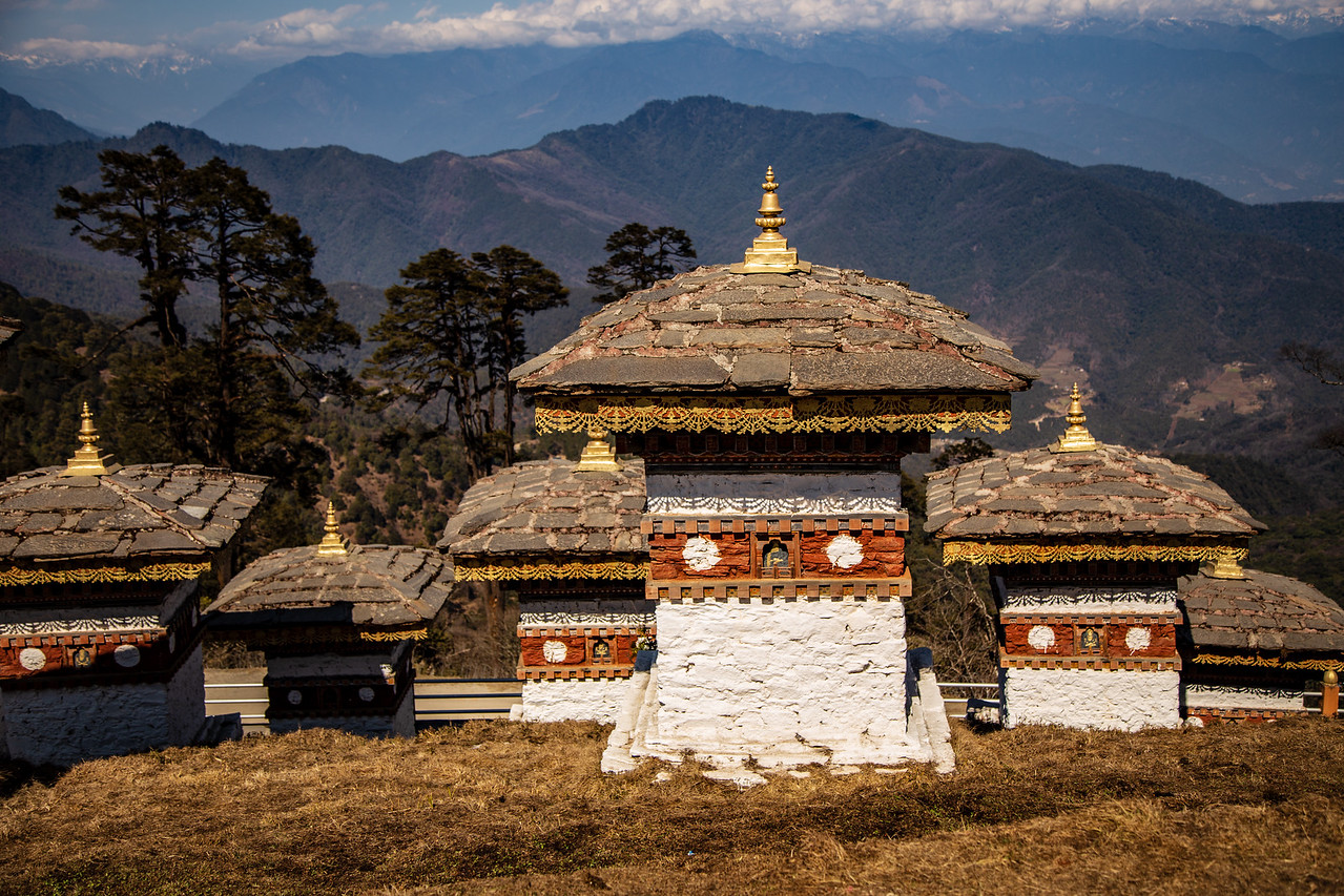 Photo of the Druk Wangyal Khang Zhang Chortens at Dochula Pass in Bhutan