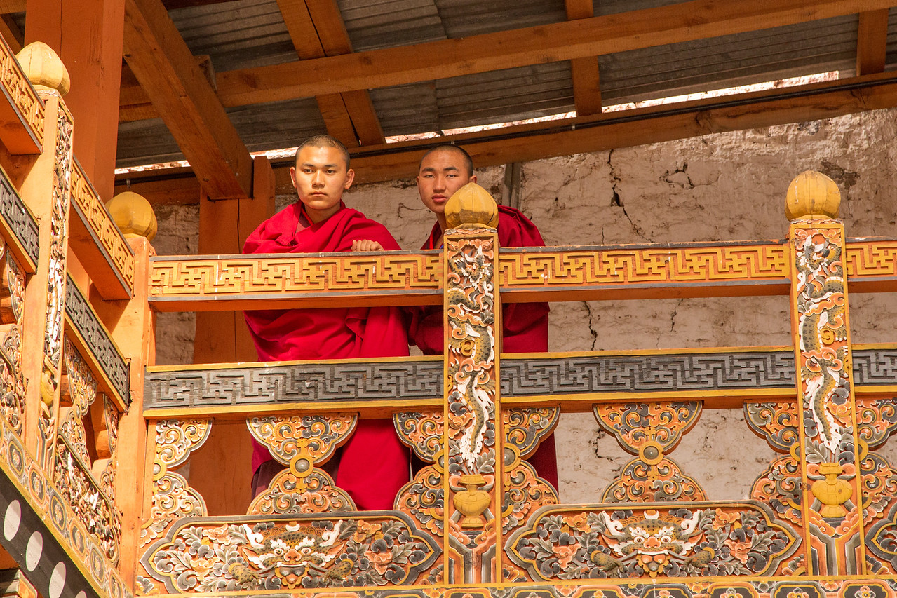 Monks Watch From a Balcony in Tashichho Dzong Near Thimpu, Bhutan