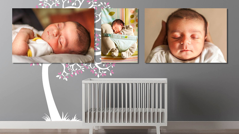 nursery with four photographs hanging on the wall of a pregnant mother to be