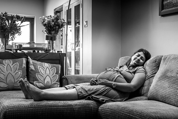 pregnant mother to be sleeping on a settee