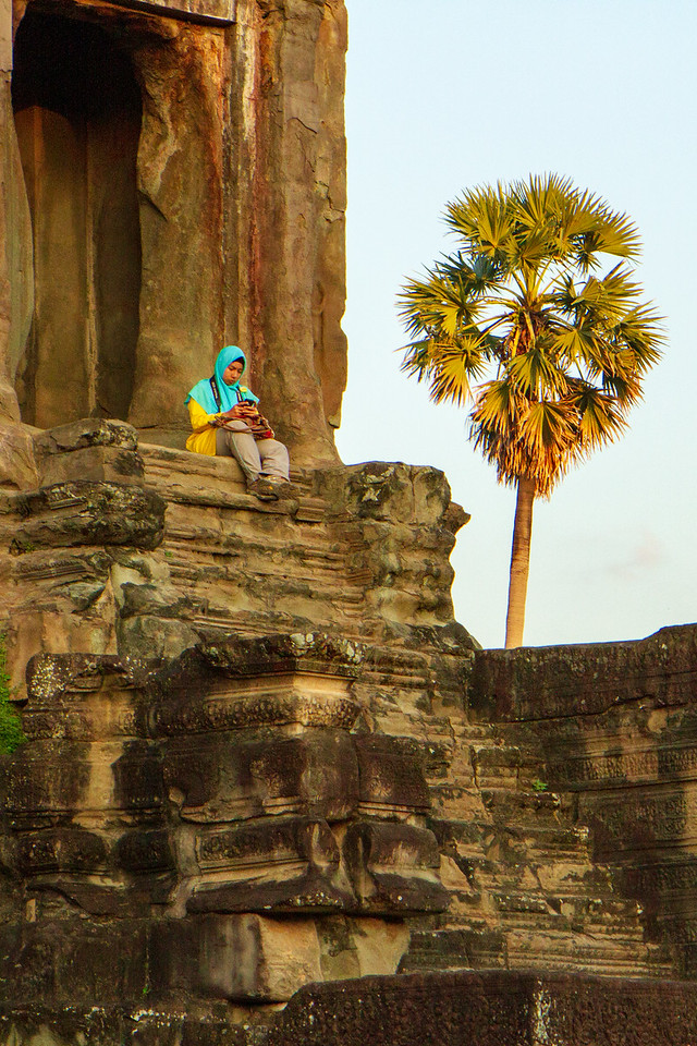 Woman Distracted by Smartphone at Angkor Wat