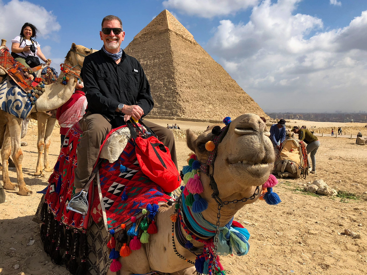 Riding a Camel in at the Pyramids of Giza